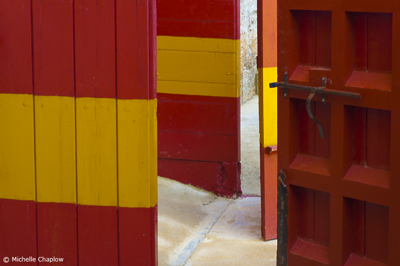 The emblematic red and yellow doors of Spain´s bullrings © Michelle Chaplow