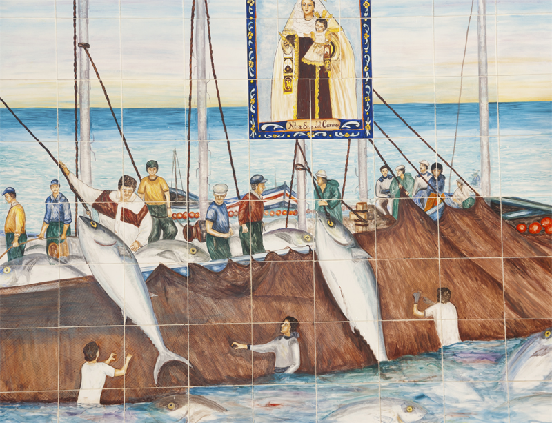 Traditional almadraba tuna fishing depicted on tiles the church in Conil