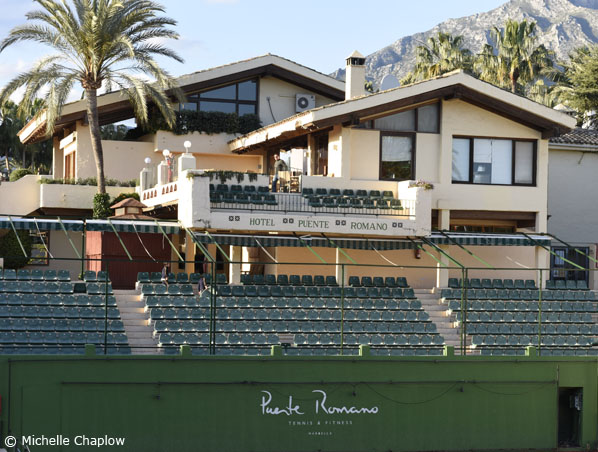A luxurious tennis court in Puente Romano.