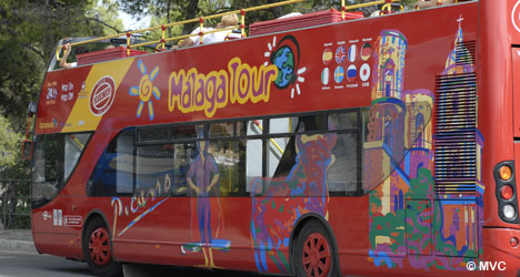 Hop-on and Hop-off the Malaga tourist bus to visit the main sights of Malaga. © Michelle Chaplow