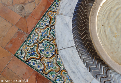 Hand-painted tiles and water fountains in Seville's grand Alcazar. © Sophie Carefull
