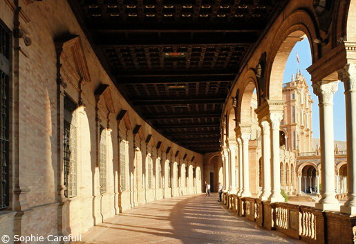 The majestic arches of Plaza de España at sunset. © Sophie Carefull