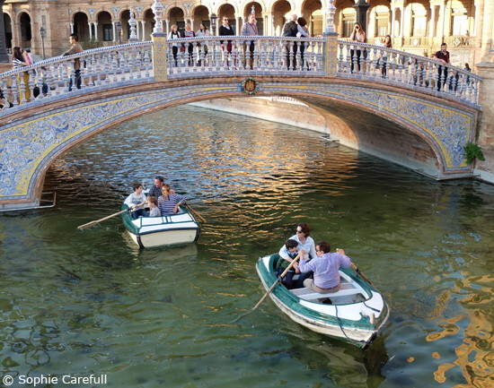 Boats on the canal in the ornately decorated Plaza de Espana. © Sophie Carefull