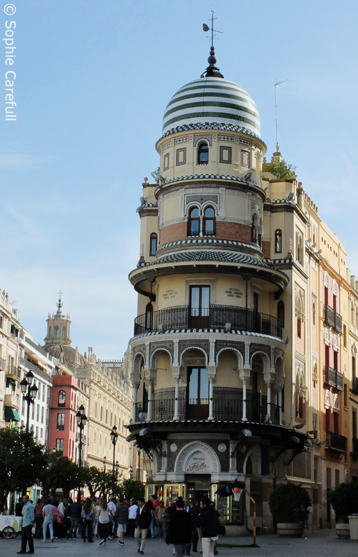 Amazing architecture on Seville's busy Calle Constitucion.  © Sophie Carefull
