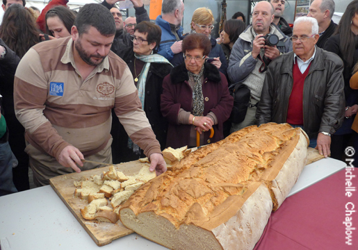 The village baker made an enormous loaf of fresh bread for the event. © Michelle Chaplow .