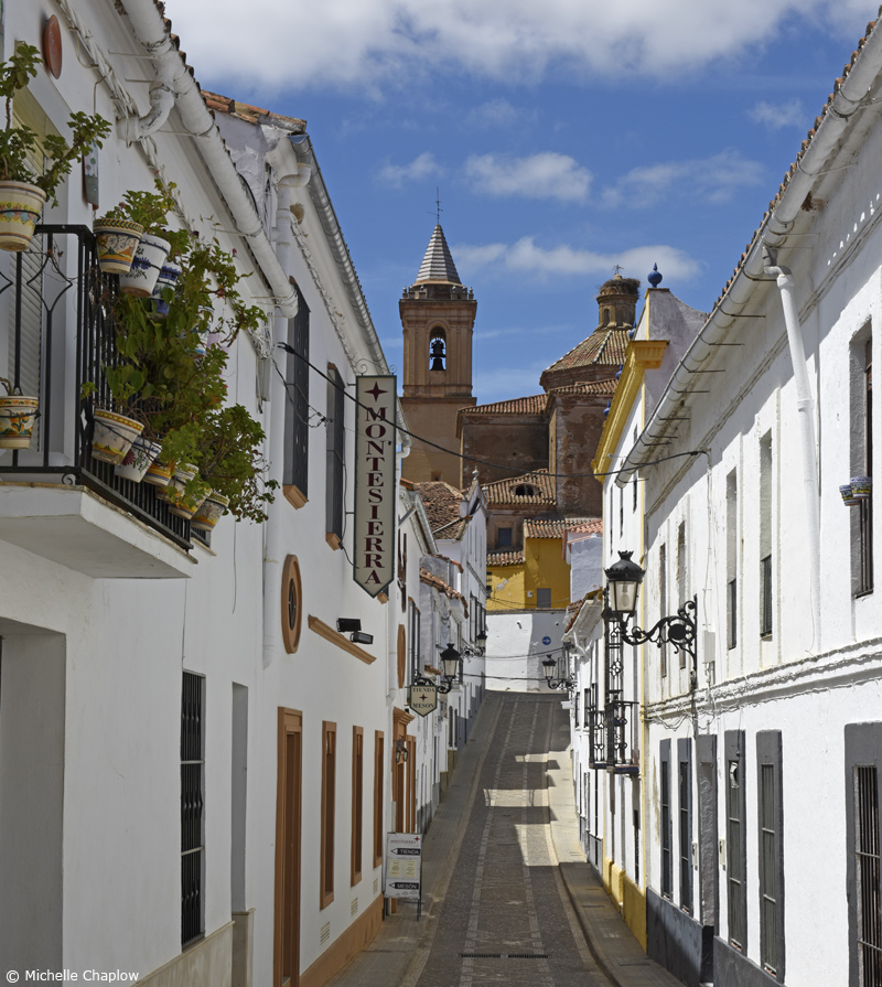 The Calle Barco from the main shopping street leads to the 18th-century Iglesia de San Miguel (Click to enlarge image). ©Michelle Chaplow