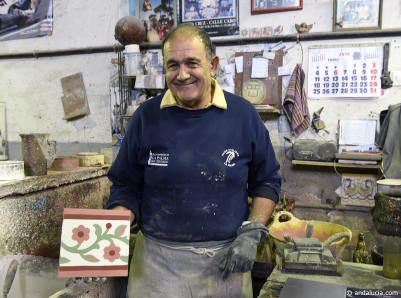 Craftsman Paco proudly displays the finished cement tile. ©Michelle Chaplow