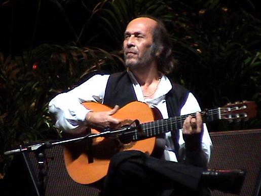 Paco de Lucia performing at Malaga Bullring. © Tony Bryant