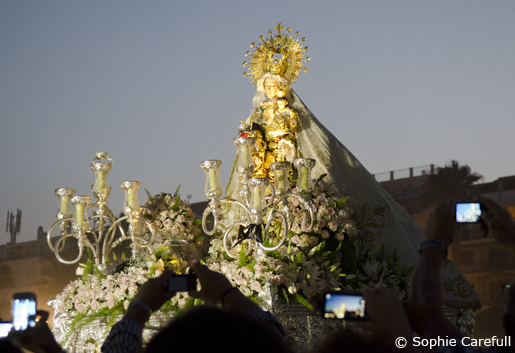 The devoted crowd taking photos of the Virgen del Carmen on Playa La Rada. © Sophie Carefull