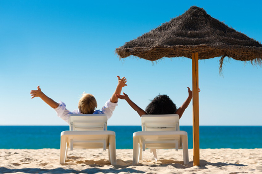 Relax and enjoy the sun, sea and sand at a luxurious beach club. © istock