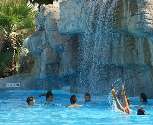 Waterfall in the pool at Aquapolis. © Aquapolis, Sevilla