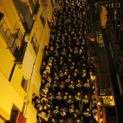Band of Las Cigarerras of La Carreteria procession in Seville takes up the entire street.