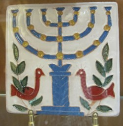 © Michelle Chaplow Ceramic tile showing the Menorah lamp