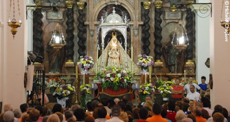 The Baroque alter of Virgin de la Sierra during the Romeria de los Gitanos.