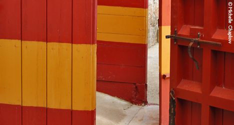 The traditional strong blood red and ochre colours of the bullring doors © Michelle Chaplow