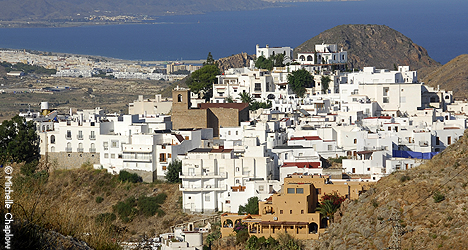 The town of Mojacar clings to a rocky hillside like a gargoyle watching over the Med © Michelle Chaplow